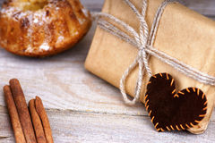 Gift box, muffin and heart shape Royalty Free Stock Photography
