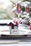 Gift Box With Name Tag On Dining Table Royalty Free Stock Image