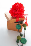 Gift box with necklace Royalty Free Stock Images