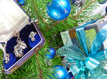 Gift box with a necklace on a New Year tree Stock Photos