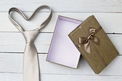 Gift box and necktie on wooden background. Top view royalty free stock photos