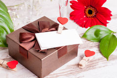 Gift box, a note and hearts for Valentine's Day. Close up, horizontal Royalty Free Stock Photos