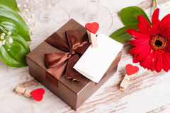 Gift box, a note and hearts for Valentine's Day. Close up, horizontal, top view Stock Photo