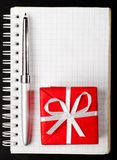 Gift box with notepad Stock Images