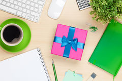 Gift box on office table Stock Photography