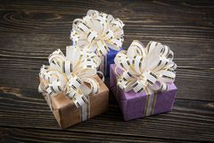 Gift box on old wooden background Royalty Free Stock Photos