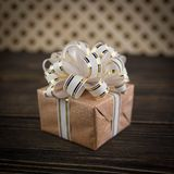 Gift box on old wooden background Stock Photos