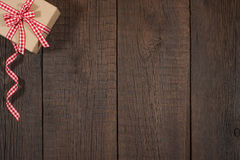 Gift box on an old  wooden table. Royalty Free Stock Photography