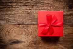 Gift box on old wooden table Stock Photography