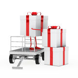 Gift box onload trolley. Red white gift box onload a trolley Royalty Free Stock Photos