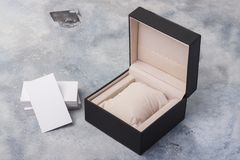 Gift box. Open the black watch box on a light background. Royalty Free Stock Image