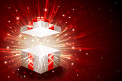 Gift Box Open Explosion Firework Magic Light Shine Background Christmas. Open gift box with shining exploding firework from glitter; For theme of christmas, new Royalty Free Stock Photo