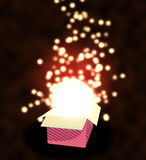 Gift  box open with  lights. Royalty Free Stock Photo