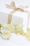 Gift box, orchid and blank card Royalty Free Stock Images
