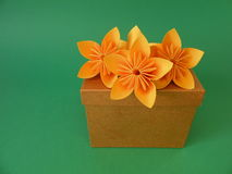 Gift box and origami flowers Royalty Free Stock Photo