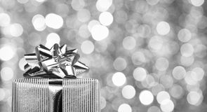 Gift box over bokeh background Royalty Free Stock Photos