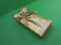 Gift box over green background Royalty Free Stock Photography
