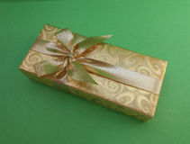 Gift box over green background Royalty Free Stock Images