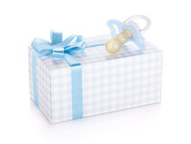 Gift box and pacifier for little boy Stock Photos