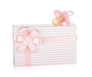 Gift box and pacifier for little girl Stock Images