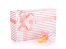 Gift box and pacifier for little girl Royalty Free Stock Photo