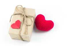 Gift box with paper red heart and red heart yarn. Gift box with paper red heart and red heart yarn on white background Stock Photos