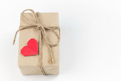 Gift box with paper red heart. Gift box with paper red heart on white background Royalty Free Stock Image