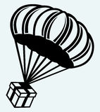 Gift box parachute falling from the sky Stock Image
