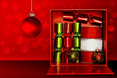 Gift Box, Party Favors, Ribbon, Christmas Ornament. Red Gift Box Filled With Red & Green Party Favors, Decorative Red & White Ribbon And Red, Green & Gold Royalty Free Stock Photos