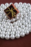 Gift box on pearl Royalty Free Stock Photo
