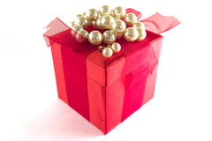 Gift box with pearls Stock Images