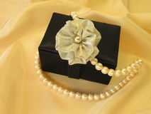 Gift box with pearls Stock Photo