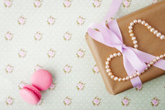 Gift box with pearls in a romantic vintage style in pastel color Royalty Free Stock Photo