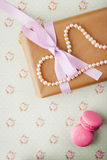 Gift box with pearls in a romantic vintage style in pastel color Stock Photography