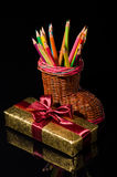 Gift box and pencils Royalty Free Stock Photos