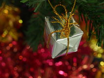 Gift box on pine tree branch and bokeh background. Stock Photo