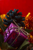 Gift box, pinecone and lametta Stock Photos