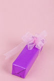 Gift box on pink Stock Images