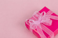 Gift box on pink Stock Photos