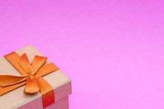 Gift box on pink background. Royalty Free Stock Photos