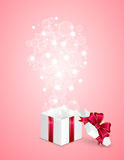 Gift box on pink background Stock Images