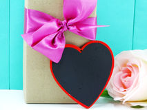 Gift box with pink bow and heart symbol Stock Photography