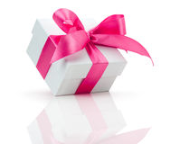 Gift box with pink bow isolated on the white background Royalty Free Stock Photos