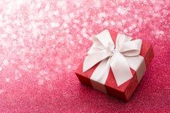 Gift Box On Pink Glitter Background stock image