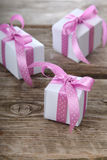 Gift box with pink and lilac ribbons Royalty Free Stock Photography
