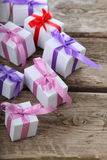 Gift box with pink and lilac ribbons Royalty Free Stock Images