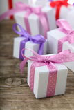 Gift box with pink and lilac ribbons Stock Photos