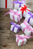 Gift box with pink and lilac ribbons Royalty Free Stock Image