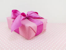 Gift box with pink polka dot background with space copy Stock Images