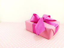 Gift box with pink polka dot background with space copy Royalty Free Stock Photography